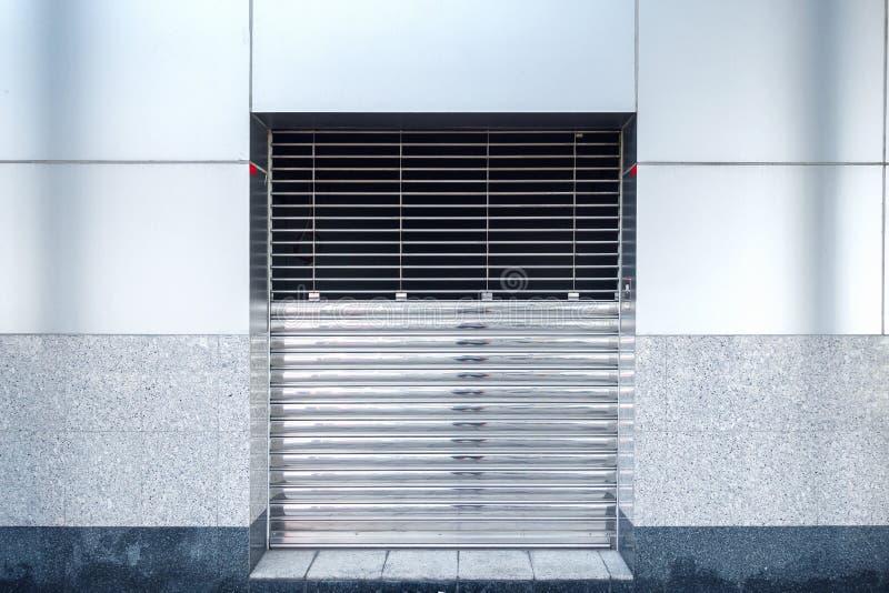 Automatic Factory Shutter Roller Door Indoor, Steel Rolling Gate Door for Security System of Warehouse Storage. Architecture Metal. Access Doorway With Granite stock images