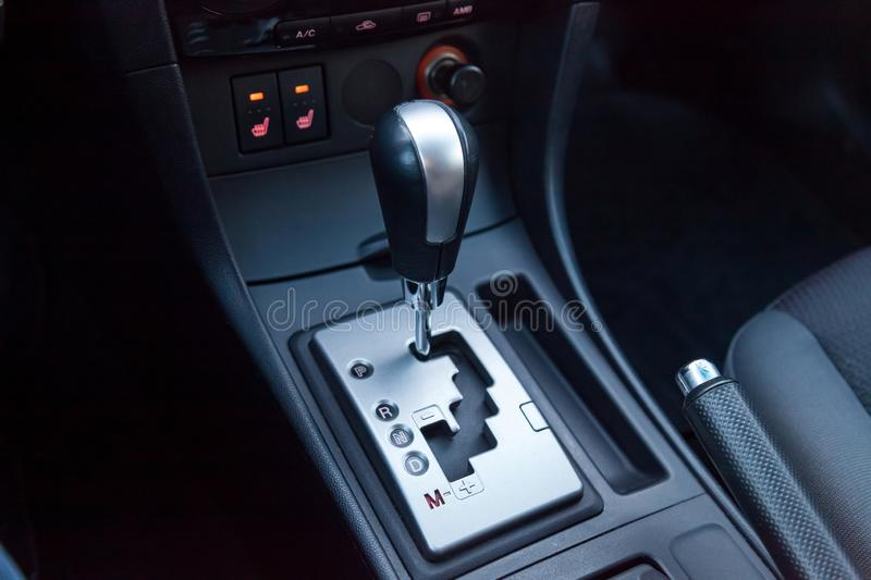 Automatic gear knob in the passenger compartment in black for driving and acceleration. Abstract image of fast speed stock images