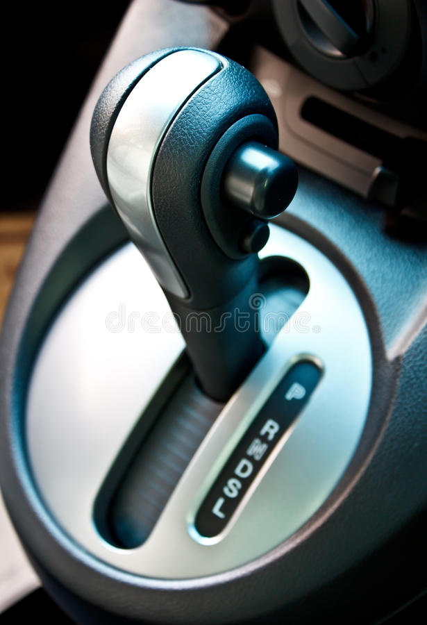 Automatic gear shift handle. Of a modern sub compact car, focus on the top of the handle royalty free stock photography