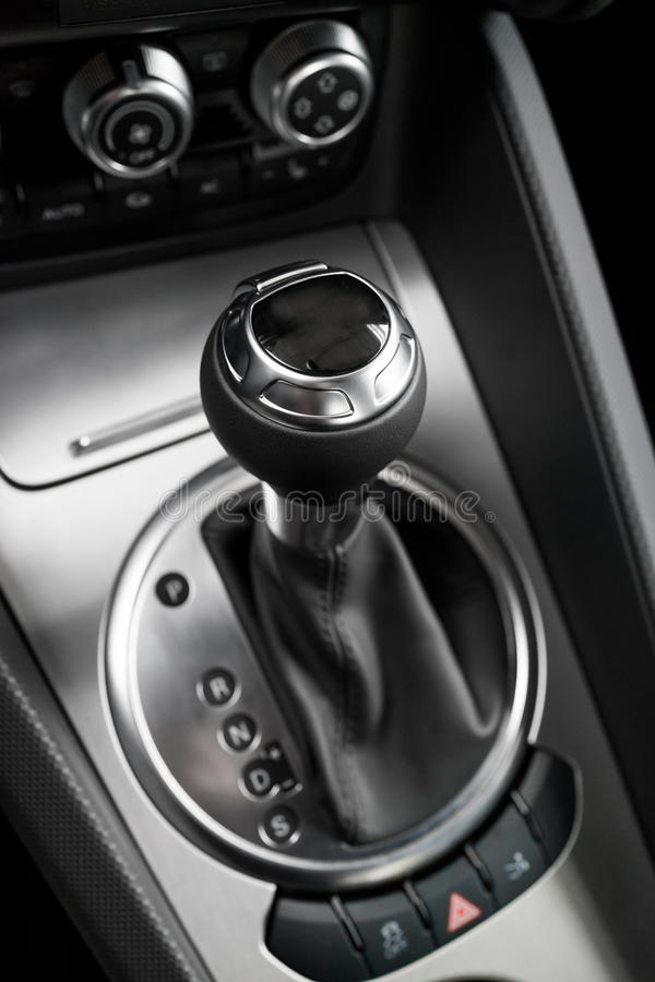 Automatic gear shift handle. Luxury sport car interior royalty free stock photo