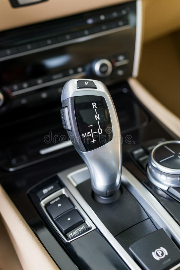 Automatic gear shift handle. Luxury sport car interior royalty free stock image