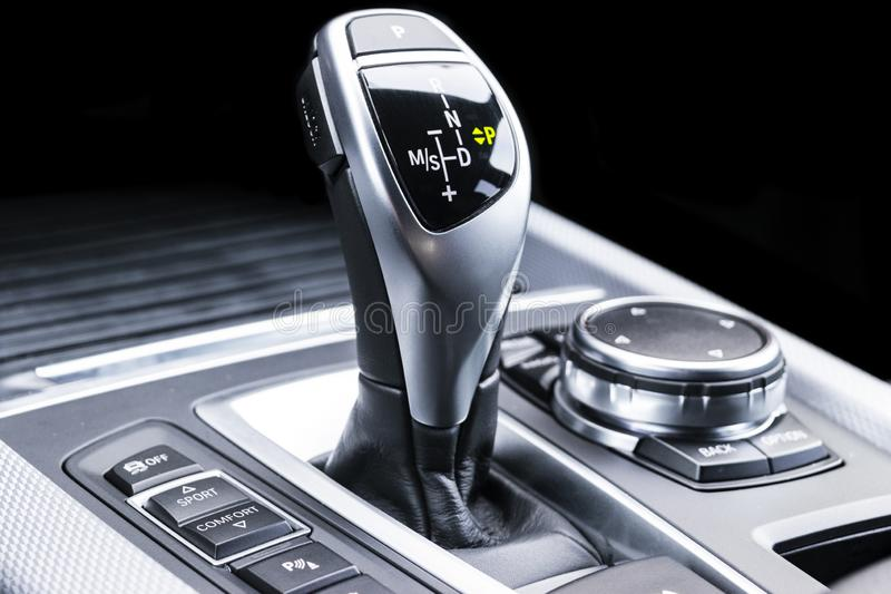 Automatic gear stick of a modern car. Modern car interior details. Close up view. Car detailing. Automatic transmission lever shif. T. Black leather interior royalty free stock photo