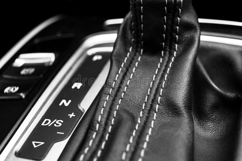 Automatic gear stick of a modern car. Modern car interior details. Close up view. Car detailing. Automatic transmission lever shif. T. Black leather interior stock photo