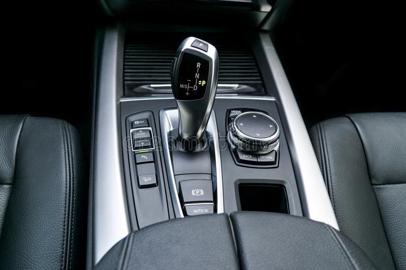 Automatic gear stick transmission of a modern car, multimedia and navigation control buttons. Car interior details. Transmission. Shift stock images