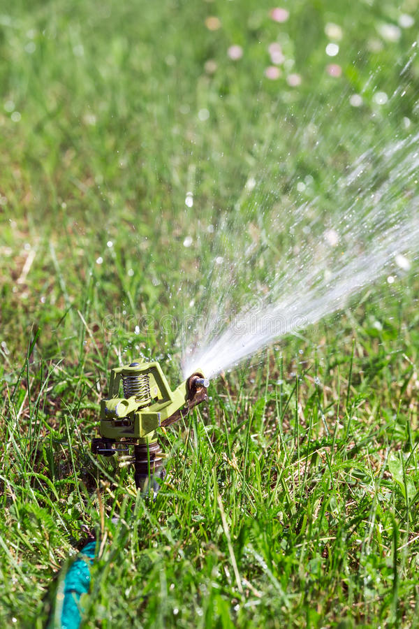 Automatic lawn sprinkler stock images