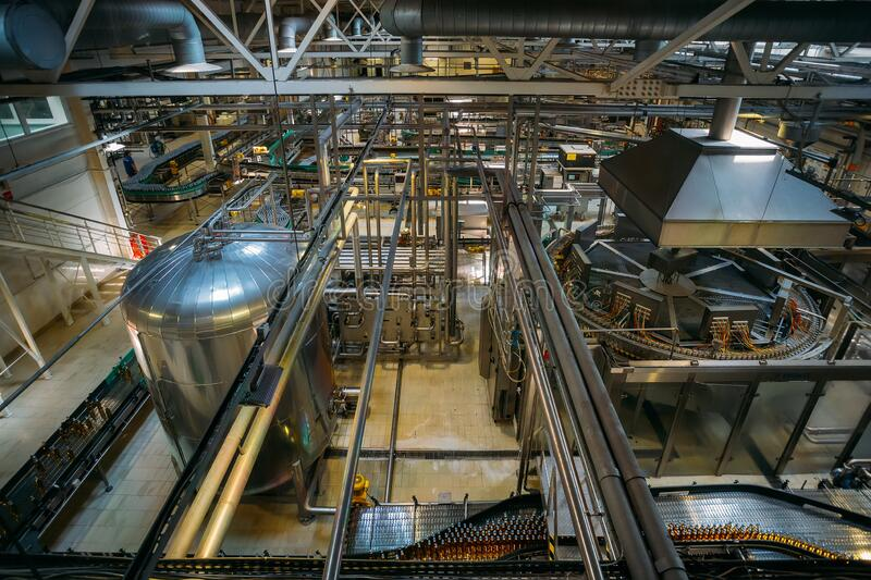 Automatic modern production line at brewery.  royalty free stock photography