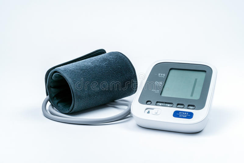 Automatic portable blood pressure machine with arm cuff on white with copy space. Automatic portable blood pressure machine with arm cuff on white with copy royalty free stock photo