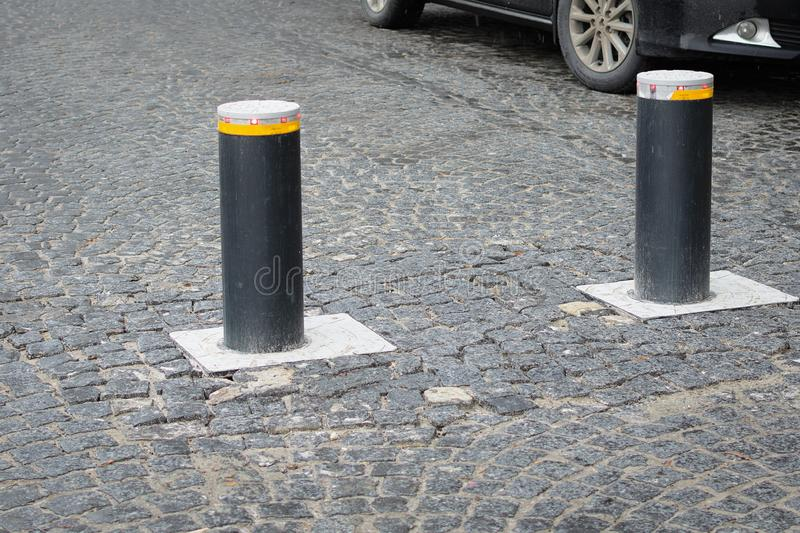 Automatic retractable bollard with glowing lights for control of road traffic and parking stock photo