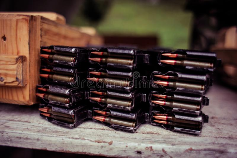 Automatic rifle cartridge with bullets. On a military shooting range stock photography