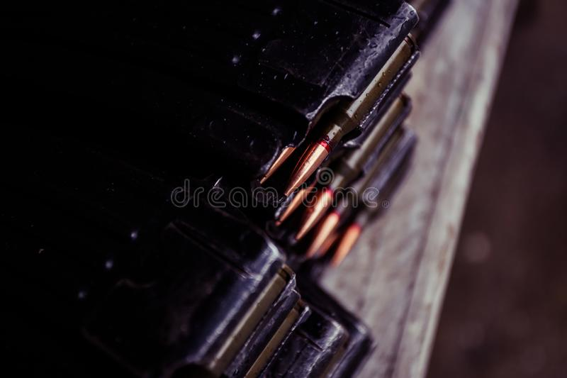 Automatic rifle cartridge with bullets. On a military shooting range stock image