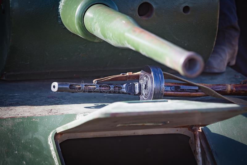 Automatic rifle of the Second World War lies on the armor of the tank royalty free stock image