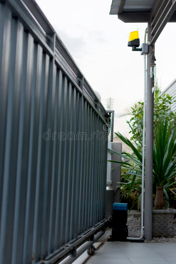 Automatic slide house metal gates stock photography