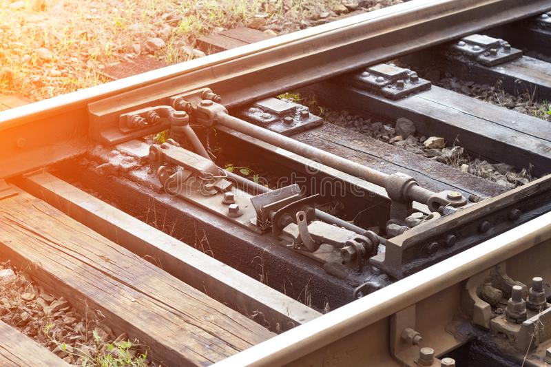 Automatic switch mechanism on the railroad, close-up, railway stock photos