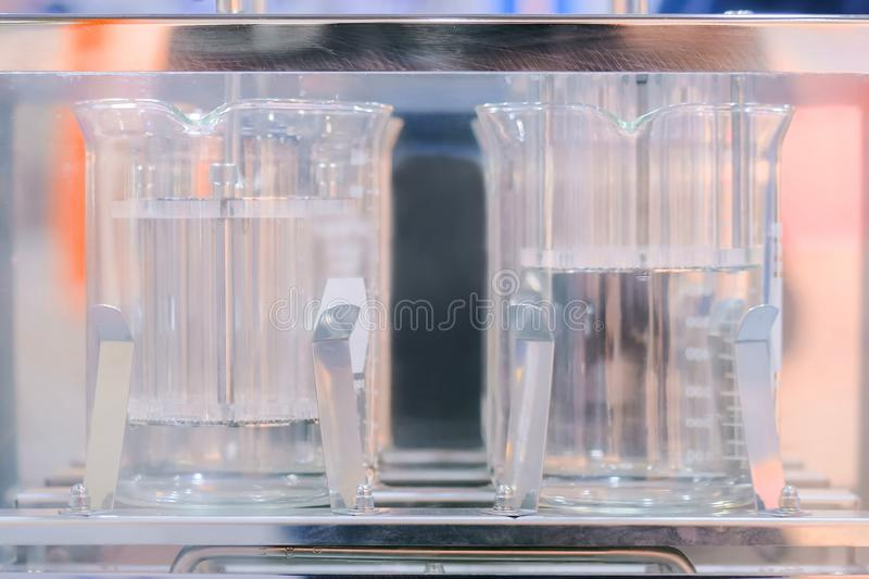 Automatic tablet disintegration and dissolution apparatus royalty free stock photo
