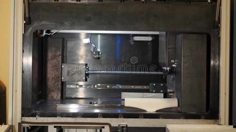 Automatic three dimensional 3d printer performs product creation. Modern 3D printing or additive manufacturing and stock image
