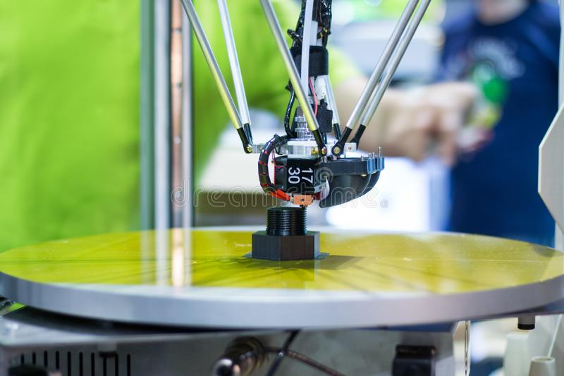 Automatic three-dimensional 3d printer performs product creation. 3d printing and automatic robotic technology, close-up royalty free stock photo