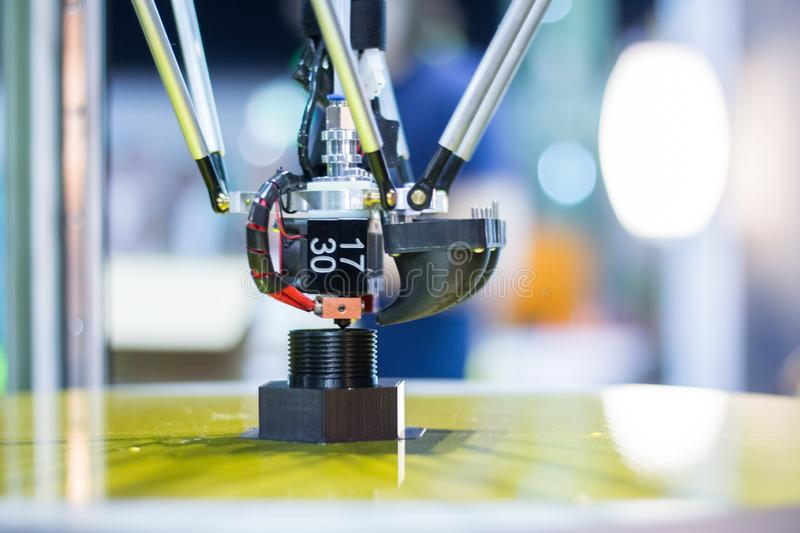 Automatic three-dimensional 3d printer performs product creation. 3d printing and automatic robotic technology, close-up. Automatic 3d printer performs a three royalty free stock image