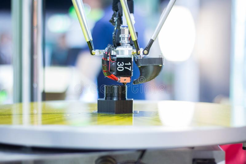 Automatic three-dimensional 3d printer performs product creation. 3d printing and automatic robotic technology, close-up. Automatic 3d printer performs a three royalty free stock photography