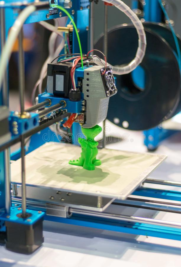 Automatic three-dimensional 3d printer performs product creation. 3d printing and automatic robotic technology, close-up. Automatic 3d printer performs a three royalty free stock photos