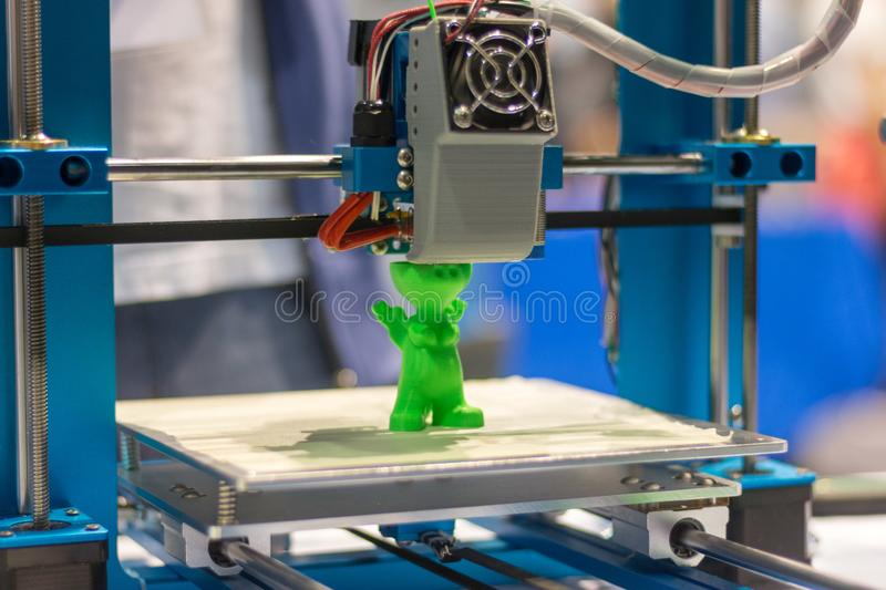 Automatic three-dimensional 3d printer performs product creation. 3d printing and automatic robotic technology, close-up stock photography