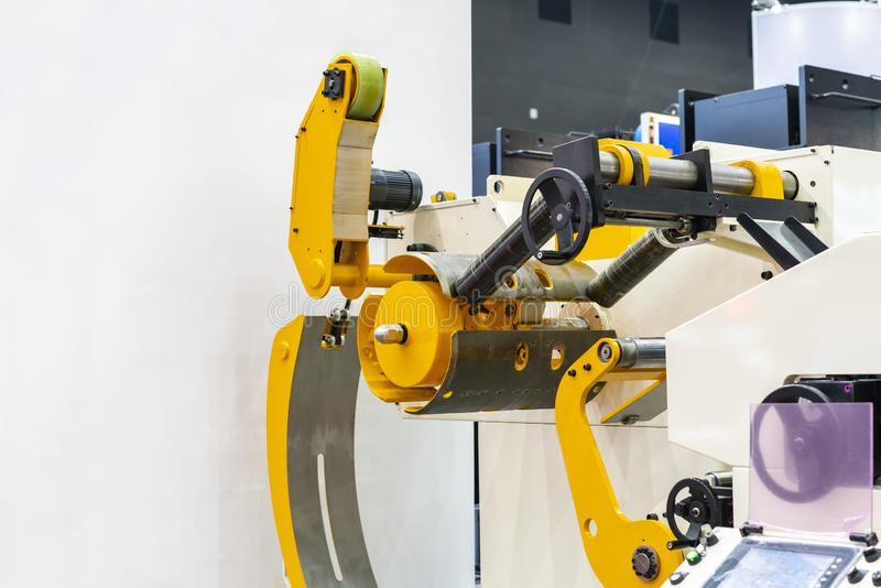 Automatic universal roll set for plastic - paper – cable – wire - cloth and other sheet or material for manufacture process in stock photography