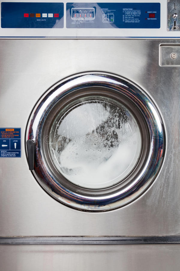 Automatic Washing Machine In Laundromat royalty free stock images