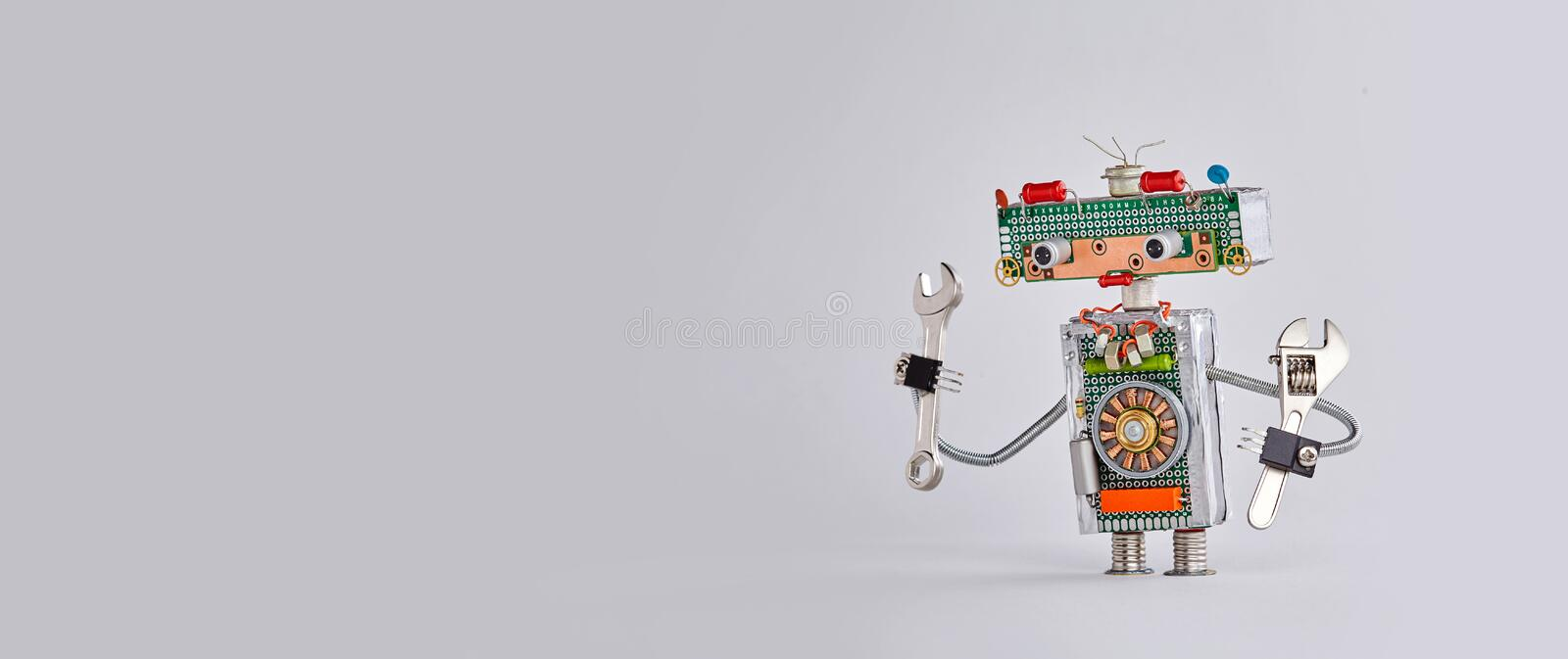 Automation maintenance robotic service works concept. Hand wrench adjustable spanner robot handyman on gary background. Copy space stock photography
