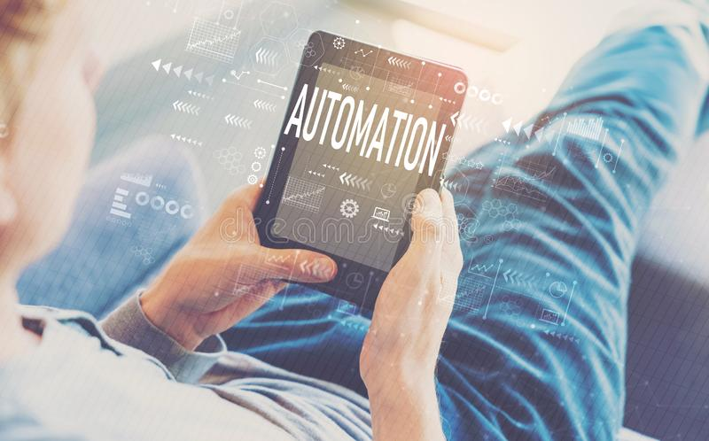 Automation with man using a tablet royalty free stock image