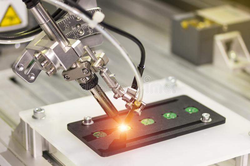 Automation robot point soldering for assembly electric circuit board PCB at factory.  royalty free stock image