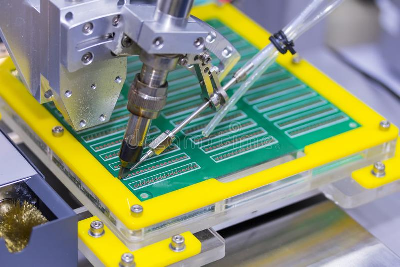 Automation robot point soldering for assembly electric circuit board PCB at factory.  stock photos