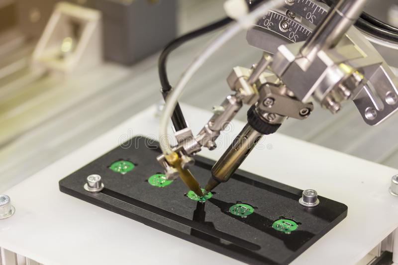 Automation robot point soldering for assembly electric circuit board PCB at factory.  stock images