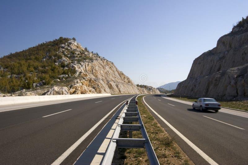 Automobil en la carretera imagen de archivo libre de regalías
