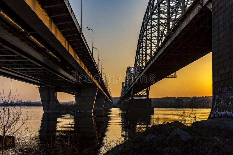 Automobile bridge over the Dnieper River. At sunset. View from under the bridge. Kiev, Ukraine royalty free stock photo