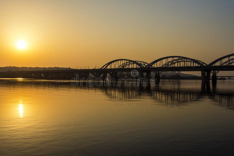Automobile bridge over the Dnieper River. At sunset. Kiev, Ukraine royalty free stock photo