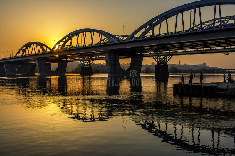Automobile bridge over the Dnieper River. At sunset. Kiev, Ukraine royalty free stock image