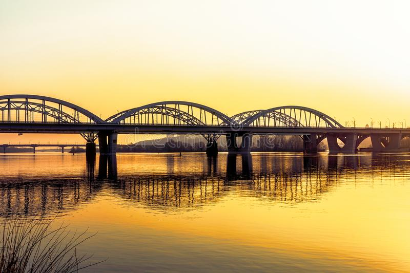 Automobile bridge over the Dnieper River. At sunset. Kiev, Ukraine royalty free stock images
