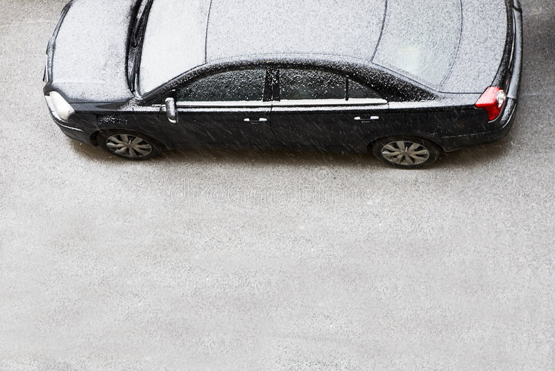 The automobile of a business - class covered by snow royalty free stock images