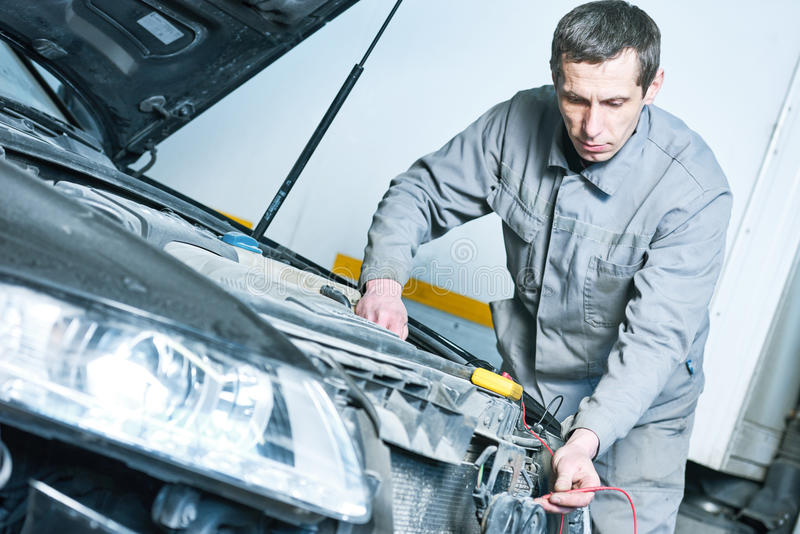 Automobile car electrician at work stock photos
