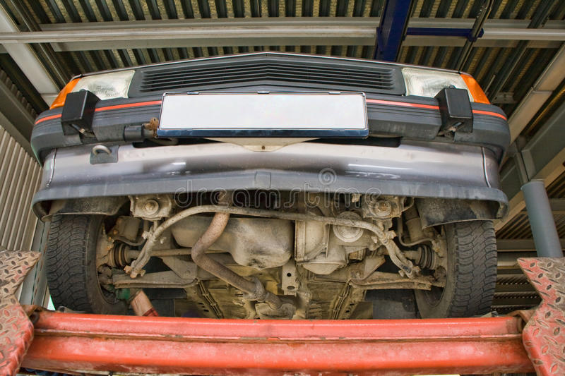Download Automobile on car lift stock image. Image of automobile - 13245099