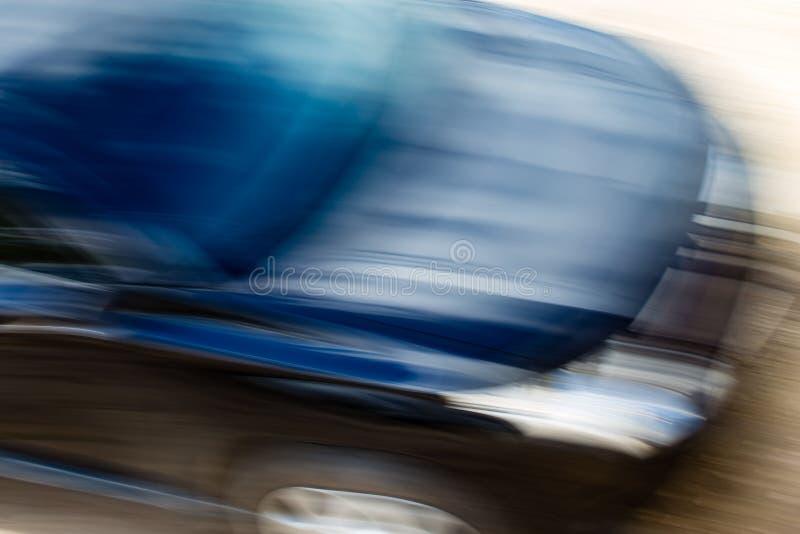 Automobile dans le mouvement comme fond abstrait images stock