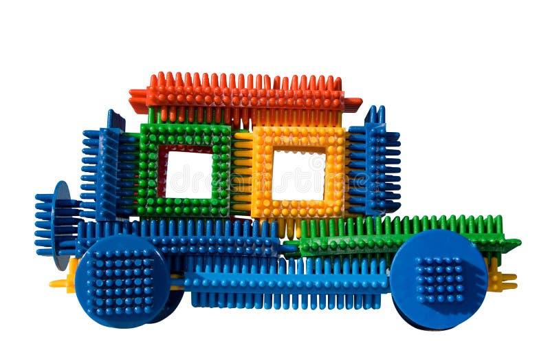 Automobile del giocattolo con il percorso di residuo della potatura meccanica fotografia stock