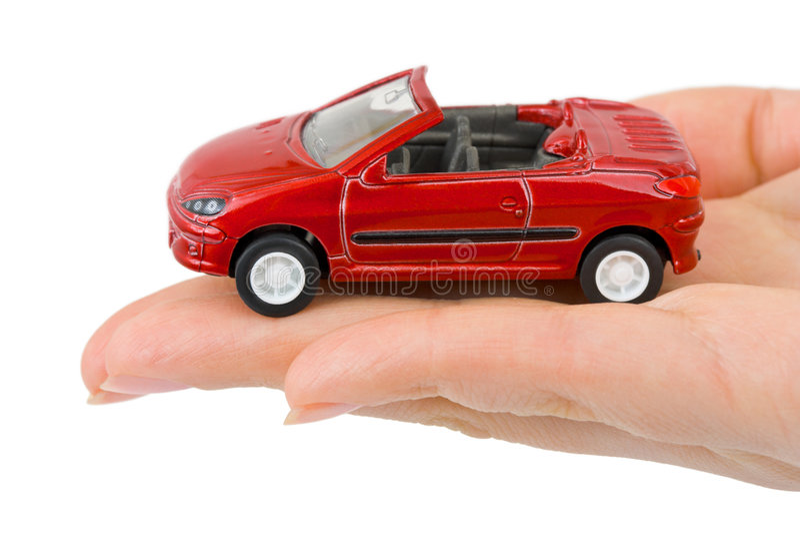 Automobile del giocattolo e della mano fotografia stock