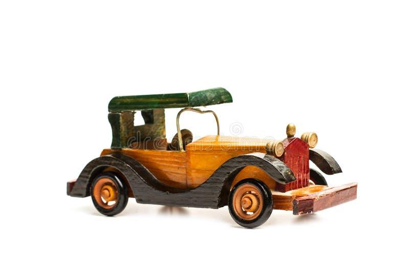 Automobile di legno d'annata del giocattolo fotografia stock