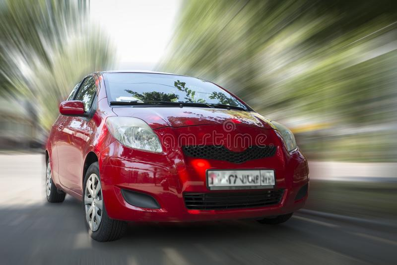 Automobile di rosso di Toyota fotografia stock libera da diritti