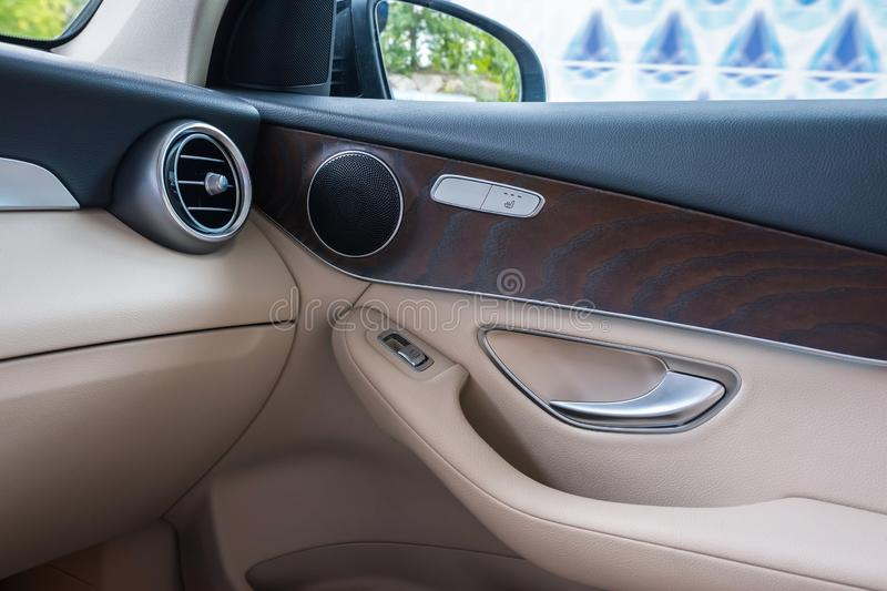 Automobile door from within. Car interior. Details close up.  Vehicle royalty free stock image