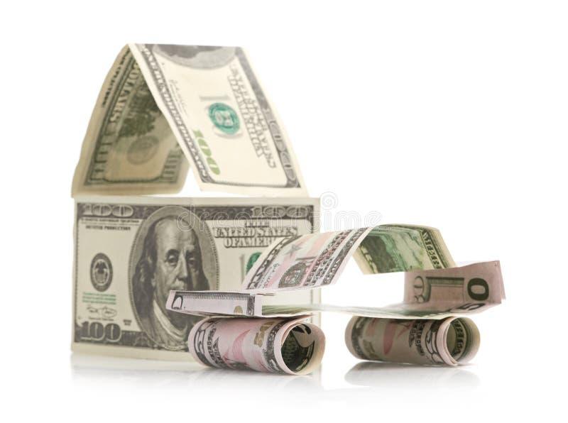 Automobile e casa fatte dei dollari fotografia stock