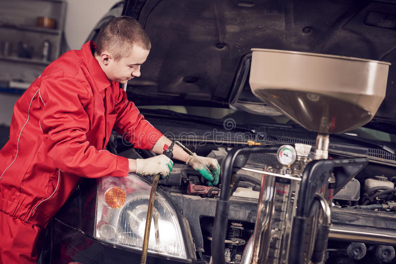 Automobile engine motor oil replacement stock photo