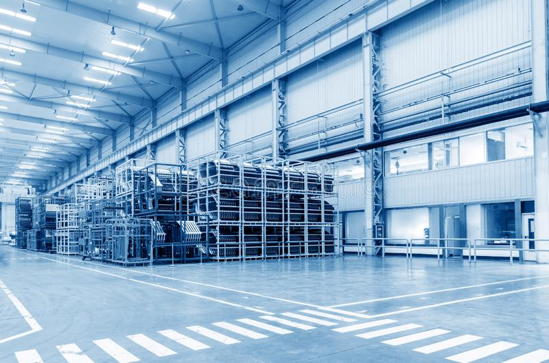 Automobile factory warehouse. The interior of a big industrial building or factory with steel constructions stock photo