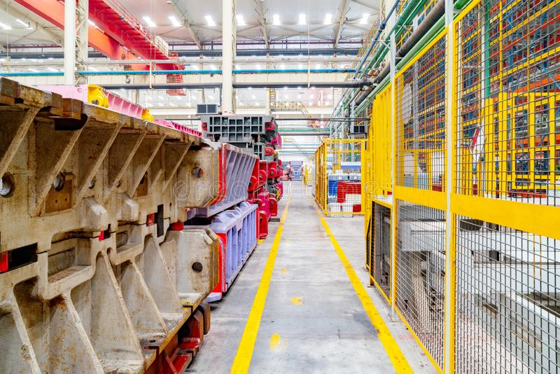 Automobile factory warehouse. The interior of a big industrial building or factory with steel constructions royalty free stock photo