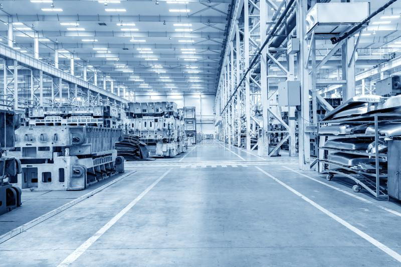 Automobile factory warehouse. The interior of a big industrial building or factory with steel constructions royalty free stock photos